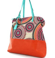 Nice tote - I have a beautiful aboriginal print shirt I never wear, think I should do this with it...