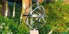 Steel armillary sundial in wild garden