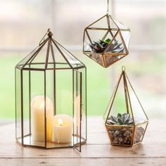 Brass style terrarium lanterns for candles or indoor gardens. Metail and glass. Three sizes and geometric shapes. Hand made. Fair trade.