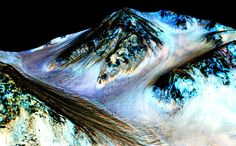 On Sept. 28, scientists revealed the discovering of the first evidence that water may flow on the surface of Mars during the planet's summer months. The picture shows what appears to be 100-meter-long streaks on the surface of Mars, seeming to have been formed by flowing water.