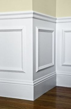 Wainscoting idea: Buy frames, glue to wall and paint over entire lower half. Done.