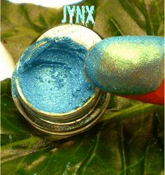 """""""Jynx"""" This is one awesome color! What starts off as a Aqua blue, rubs down to a metallic, blue/ green gold. Because of the amazing color shift of this eyeshadow , it is a great color for all eye shades!"""