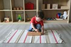 Joshua with mini knobbed cylinders (Montessori at home with a 20 month old)