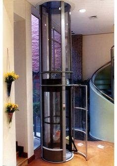 Many different issues and options to consider when putting in a home elevator for now or for staying in your home over time. Pictured is a hydraulic elevator that works like the tube at the post office and is now available larger for wheelchairs and/or multiple people. The article, comments and links offer extensive areas to consider when installing the space for or the actual elevator.