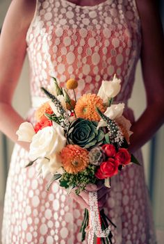 White and orange bridal bouquet with succulent