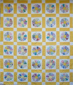 I like the quilting on this. Simple, but effective. Vintage-Dresden-Plate-Quilt by Martha at Q is for Quilter