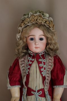 French antique Triste Jumeau Bebe doll.