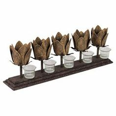 """Metal tulip-shaped candleholder.   Product: CandleholderConstruction Material: MetalColor: Weathered gray and tanAccommodates: (5) Candles - not includedDimensions: 7.48"""" H x 20.47"""" W x 4.72"""" D"""