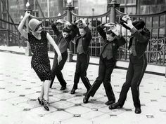 vintage everyday: American woman teaching English boys to dance the Charleston, Great Britain, 1925