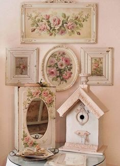 So shabby. Gorgeous frames and cabbage roses- dreamy!