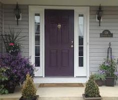 purple front door - gray siding - maybe