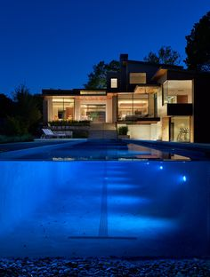Beautiful pool and rear view of contemporary home in Bluffview by BufordHawthorne