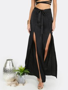 Long Wide Leg Decorated with Belted, Split. Loose fit. Mid Waist. Plain design. Trend of Spring-2018, Fall-2018. Designed in Black. Fabric has no stretch.