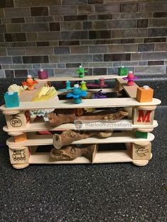 Handmade craft stick play area for my conures.