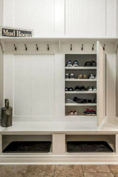 Custom mudroom storage with concealed shoe storage, 8 hooks for coats and two large cubbies. 8 Fun and Functional Mudroom Ideas for a Super-Organized Your Home Storage Entryway Laundry Shelves, Mudroom Laundry Room, Laundry Room Design, Laundry Storage, Closet Mudroom, Garage Closet, Mud Room In Garage, Front Closet, Shoe Shelves