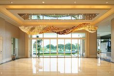 Golden Summer lighting installation gives the impression of late-afternoon rays shining at raised sand grains. Modern Entrance, Lobby Lounge, Office Space Design, Glass Installation, Surabaya, Light Art, Valance Curtains, My House, Lights