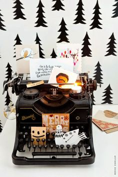 cuuuute!! love this vintage typewriter decorated with holiday knick knacks
