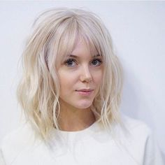 Long Platinum Bob with Wavy Fringe and Parted Bangs - Get this Hairstyle:http://hairstyleology.com/long-platinum-bob-with-wavy-fringe-and-parted-bangs/ #BangsHairstylesFringe