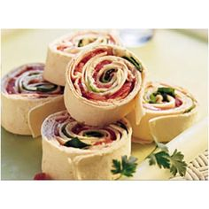 Tortilla wraps with cream cheese, smoked turkey, spinach, tomato, cheese