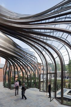 British designer Thomas Heatherwick has completed work on a new complex for gin company Bombay Sapphire at Laverstock Mill Distillery in Hampshire, England, including two sculptural glasshouses that are heated using warm air created during the distilling process