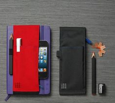 Moleskine journal notebook with sleeve to hold pen, phone, etc