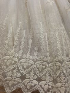 This fabric is a graceful , first quality lace fabric, very hot pattern in this summer .  * Floral embroidered lace fabric: ivory in color . two borders