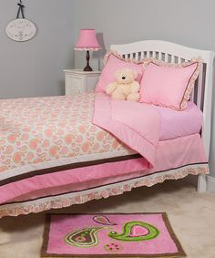 Beautify that big-girl bed! A celebration of pretty pinks and popping prints, this perfectly coordinated bedding set ensures the princess's approval.