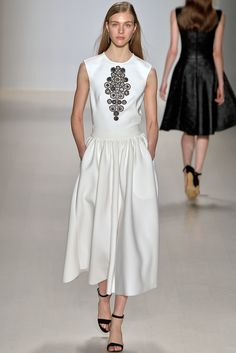 Wear: Ivory Skirt, White Sleeveless Blouse, & a Bold Black & Silver Beaded Necklace to re-create this look, & Black Heels/Flats. (Tadashi Shoji Fall 2015 Ready-to-Wear)