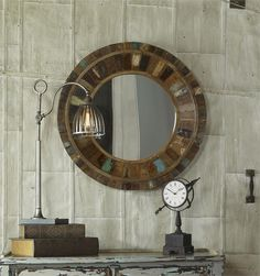 The frame of this unique mirror is made from individual panels of reclaimed vintage doors fastened to solid mango wood. Due to the unique materials colors will vary on each piece.