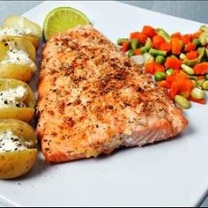 Spicy Baked Salmon (4 servings): 1000 grams Salmon filets,  2 clove Garlic,  4 tablespoons Onion,  3 teaspoons fresh ground pepper,  1 1/2 teaspooons Paprika,  1/2 teaspoon Cayenne,  1 1/2 teaspoon Dried thyme,  1/2 teaspoon Salt,  3 tablespoons olive oil.   Combine all seasoning ingredients and spread over the surface of the salmon. Bake (skin-side down) in a 350 F oven for 20 - 30 minutes.