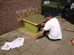 D. van der Ploeg making street art datsja for russia holland year 2013. www.denkbeelden.com