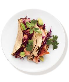 If you prefer a slaw with bold taste, prep this part of the recipe first. That way, the cabbage has more time to soften up and the flavors have more time to develop. Top each fish taco with a generous serving of the tangy salad.