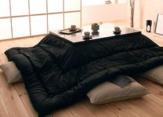 Kotatsu. It's a table with a heater on the underside (fire-safe). I want one so bad, in a tatami mat room. :)