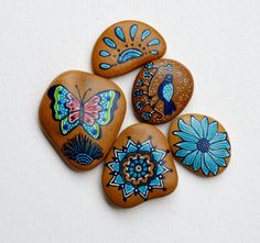 Beach stone with hand-painted designs in acrylics    These stones are unique with their design. I paint and draw all of my original designs