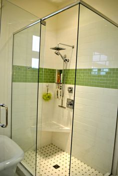 Green and white shower with subway tile serving as an accent