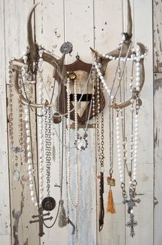 Love all the gorgeous jewelry on these antlers!