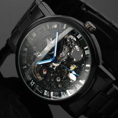 BLACKOUT delivers immense style and quality in an instant. The black steel is supercharged by the striking phantom mechanics and blue dials. Get Yours Quick! -This price only lasts for the next 25 or so orders. MOVEMENT IS MECHANICAL HAND-WIND