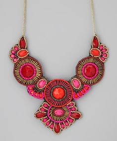 An adventurous, personal style blossoms from pieces like this bib necklace. A medley of pink, red and gold seed beads inspire fashionable freedom.