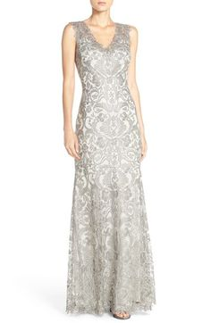 Free shipping and returns on Tadashi Shoji 'Kelly' Embroidered Mermaid Gown at Nordstrom.com. Impeccable embroidery takes on classic lace characteristics on a statuesque evening gown framed by a romantic illusion yoke and flared mermaid hem.