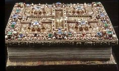 The Lindau Gospel Book Cover. The book was made in 750 – 800 AD near Salzburg. Book cover made in gold, silver, enamel, and decorated with jewels. They don't make book covers like this anymore!
