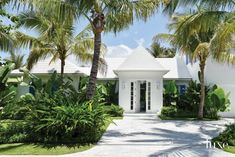 The stucco exterior—with plenty of statement-making architectural elements—achieves an airy feeling. Palm Beach Florida, Florida Home, Beach Landscape, Landscape Design, Stucco Exterior, Modern Exterior, Exterior Paint, Palm City, Home Landscaping