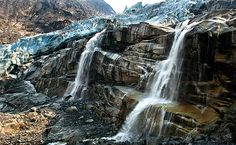 Waterfalls form from the melting runoff of the Tahumming Glacier in British Columbia. <i>(Image Credit: James Balog/Earth Vision Trust/Yale Environment 360)</i>