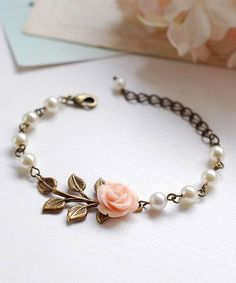 Peach Pink Flower Brass Leaf Ivory Cream Pearls bracelet by LeChaim on Etsy. This is gorgeous!!