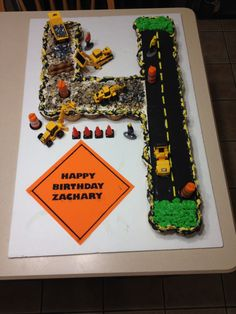 Construction cupcake cake. Could do this for Harry.