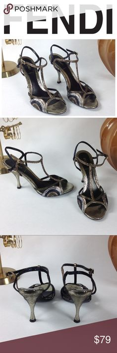 Authentic FENDI Mixed Metallic T-Strap Sandals Stunning authentic Fendi leather T-strap sandals featuring gold, silver, copper and black details. These shoes make statement f sophistication with gold Fendi logo clasp. Excellent used condition with no visible marks or scratches. Thanks for your interest!  Please checkout the rest of my closet. Fendi Shoes Sandals
