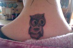 Owl tattoo on neck love it