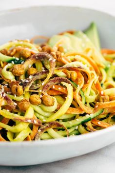 Spiralized Vegetable Salad with Roasted Chickpeas - Make yourself a healthy rainbow of colors for your next vegetarian meal and topped with a creamy avocado lemon sauce. | jessicagavin.com