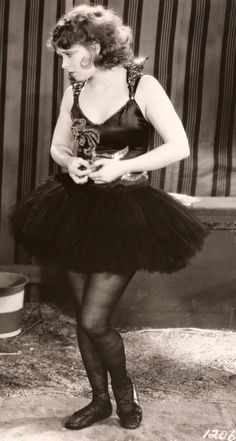 Clara Bow wearing a black tutu with sequins in Dangerous Curves (1929).