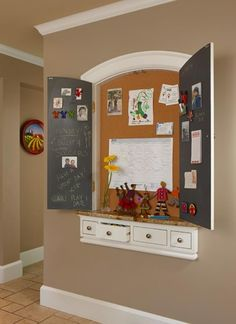 Do a shadow box, put Shelley's painting over it ( or just make doors like this) and put on the wall where her painting is.  Then when we have company, I can close it up .. . viola!!  No ugliness. :)