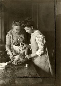 Woman and girl preparing goose, 1915 | by OSU Special Collections & Archives : Commons
